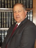 District Attorney Travis J. Koehn